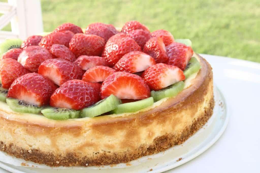 Strawberry Kiwi Cheesecake on a table.