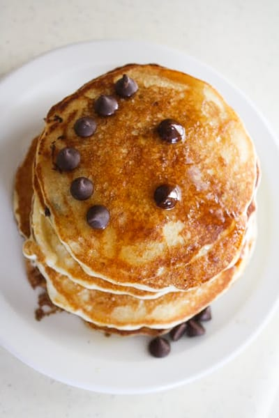 Top down shot of stack of chocolate chip pancakes.