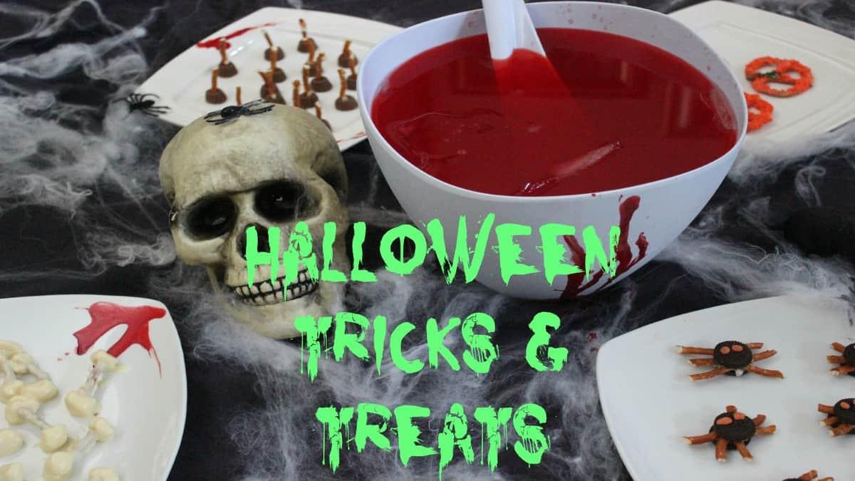 DIY Halloween Treats & Snacks on a black table.