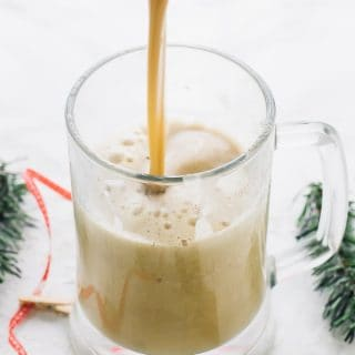 This Boozy Christmas Spiced Eggnog will become your new favourite eggnog! It's flavored with spiced rum, lots of Christmas spices and is warm and frothy!