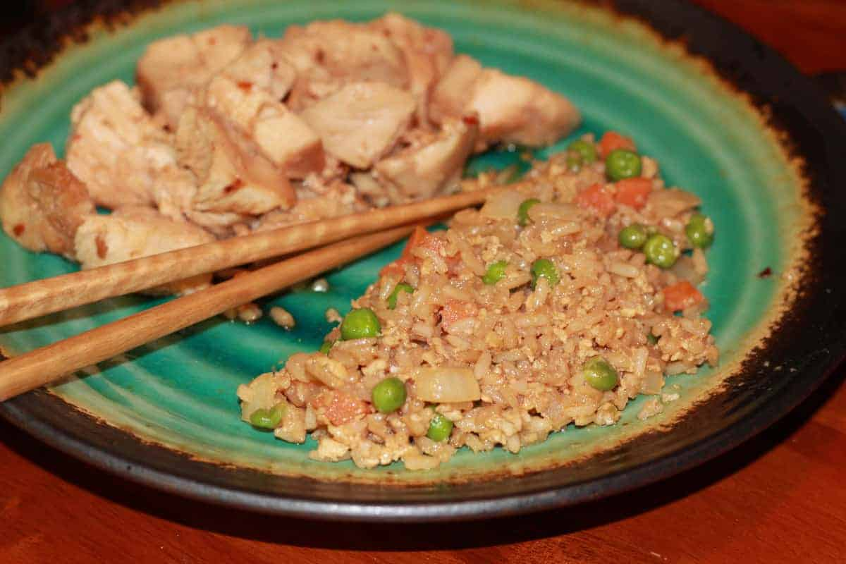 A green plate with Fried Rice.