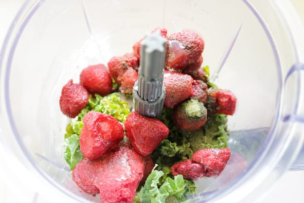 Strawberry and kale in a blender.