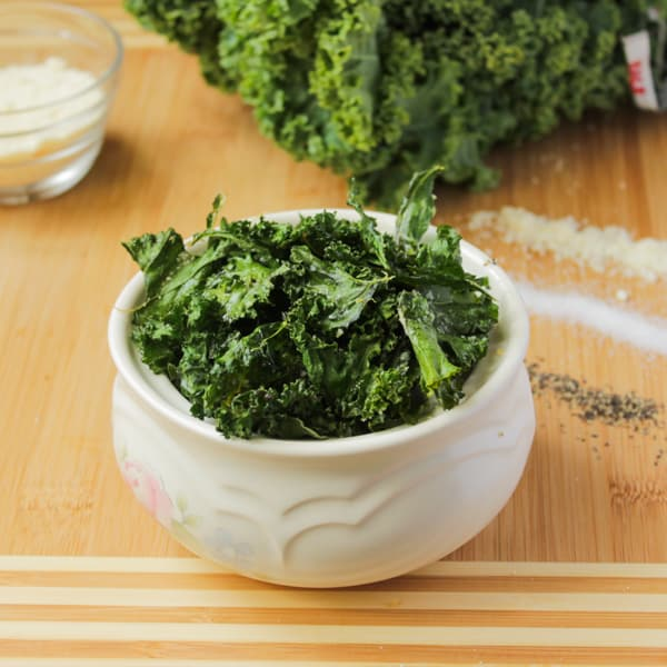 Side shot of bowl of kale chips.