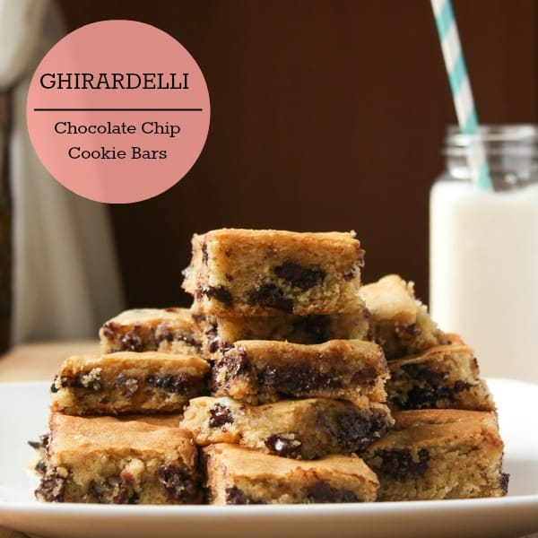 A batch of Ghiradelli Chocolate Chip Cookie Bars on a white plate.
