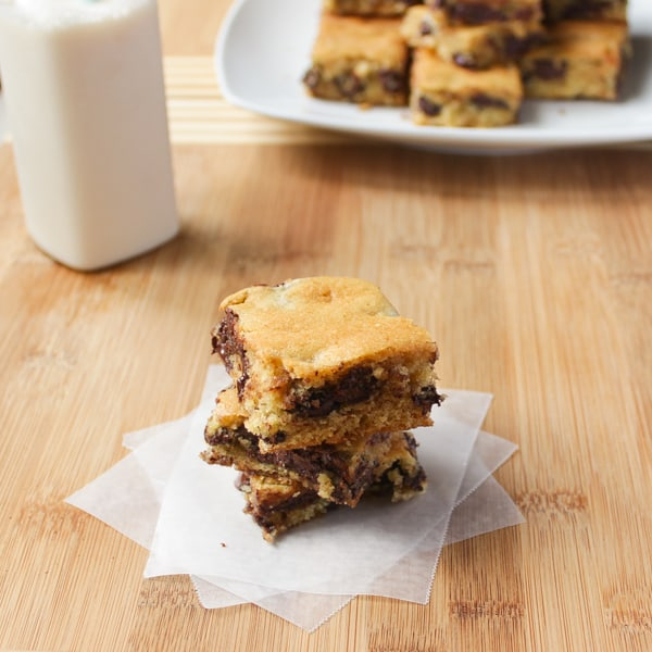Ghirardelli Chocolate Chip Cookie Bars  on a wooden table.