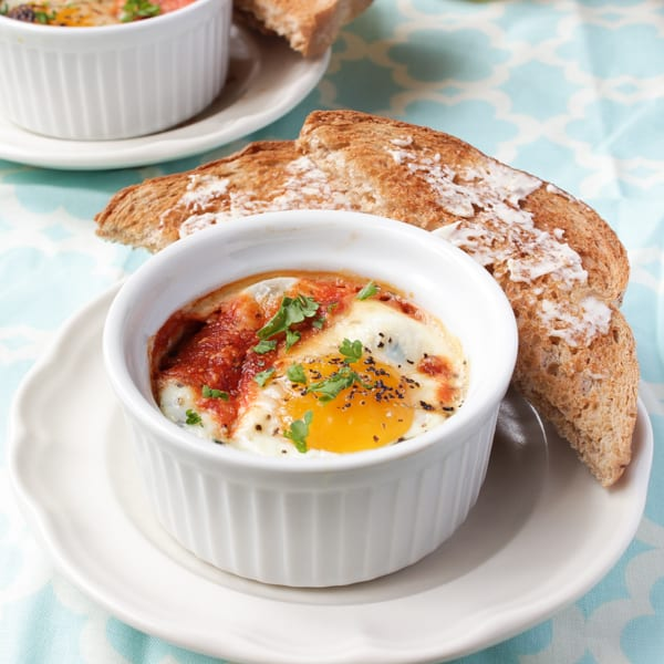 Baked eggs in a ramikin with toast.