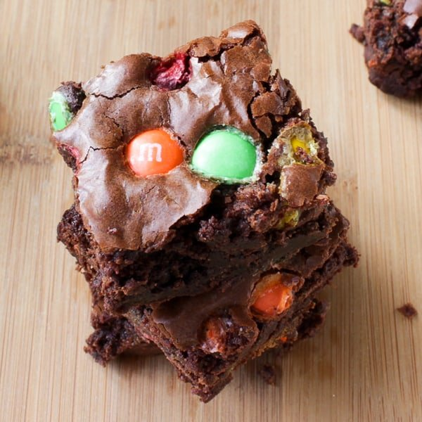 Overhead shot of Double Chocolate M&M Brownies on a wooden table.