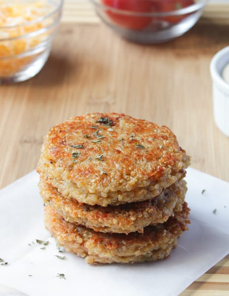 A stack of sundried tomato and mozzarella quinoa burgers.
