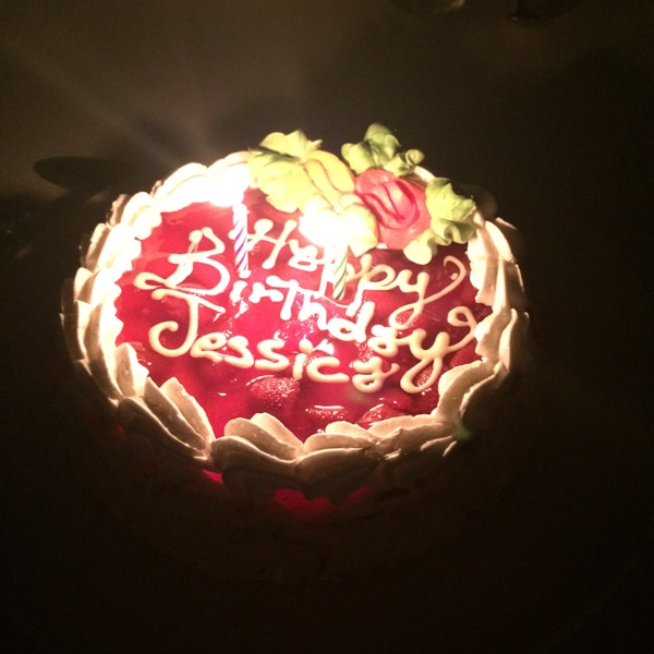 Cheesecake birthday cake with candles.