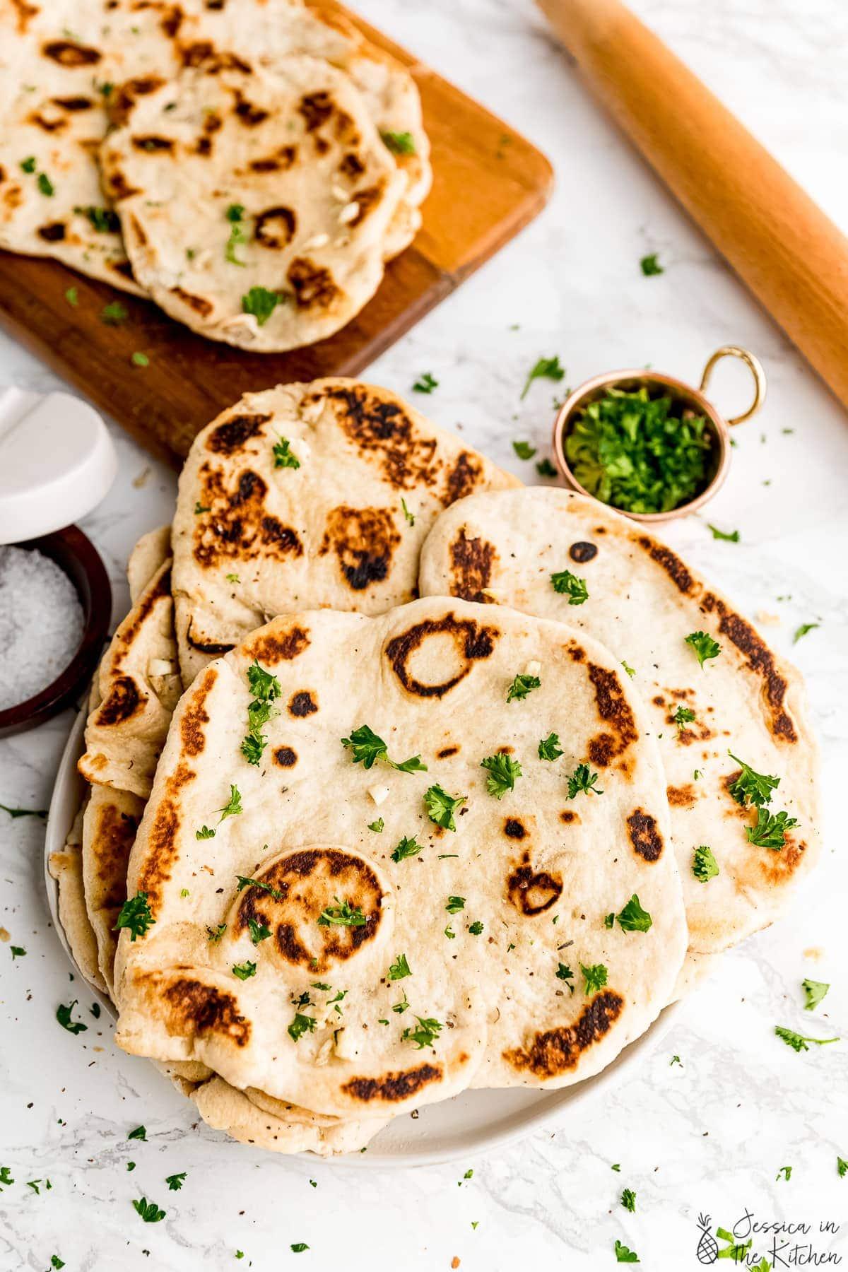 Plate of vegan naan loaves.