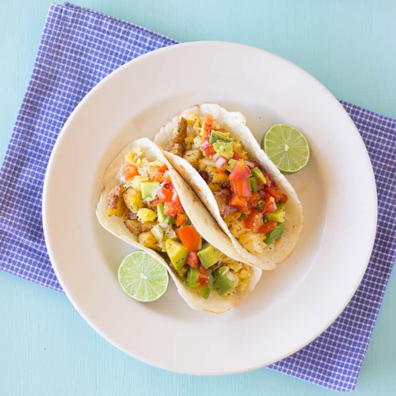 Overhead shot of breakfast tacos with avocado pico de gallo salsa.