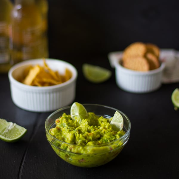 Spicy guacamole in a glass bowl.