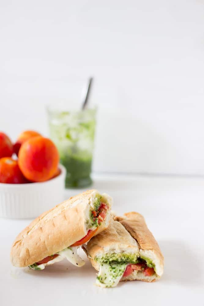 This Caprese Sandwich takes a twist by being toasted with melted mozzarella, and creamy parsley pesto. The sandwich is perfect for an everyday lunch or a picnic! | https://jessicainthekitchen.com