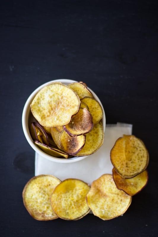 Top down shot of chips in a white ramekin.