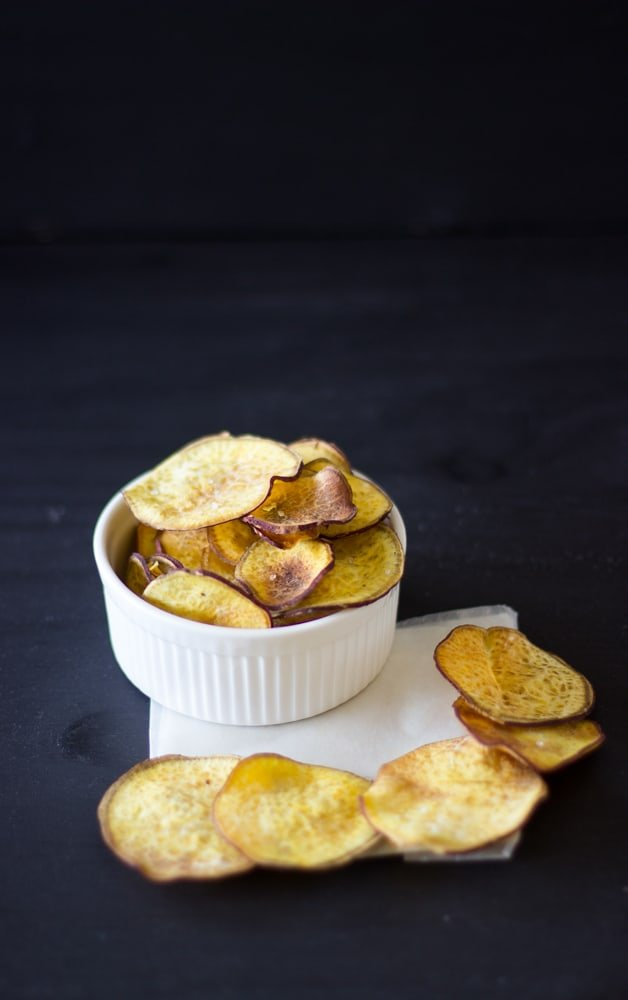 Sweet Potato Chips in a ramekin on a napkin.