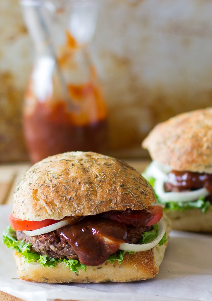 These Vegan and Gluten Free Black Bean and Quinoa Burgers with Strawberry BBQ Sauce will transform the way you see veggie burgers...they are loaded with flavour, texture and are so filling!  via https://jessicainthekitchen.com