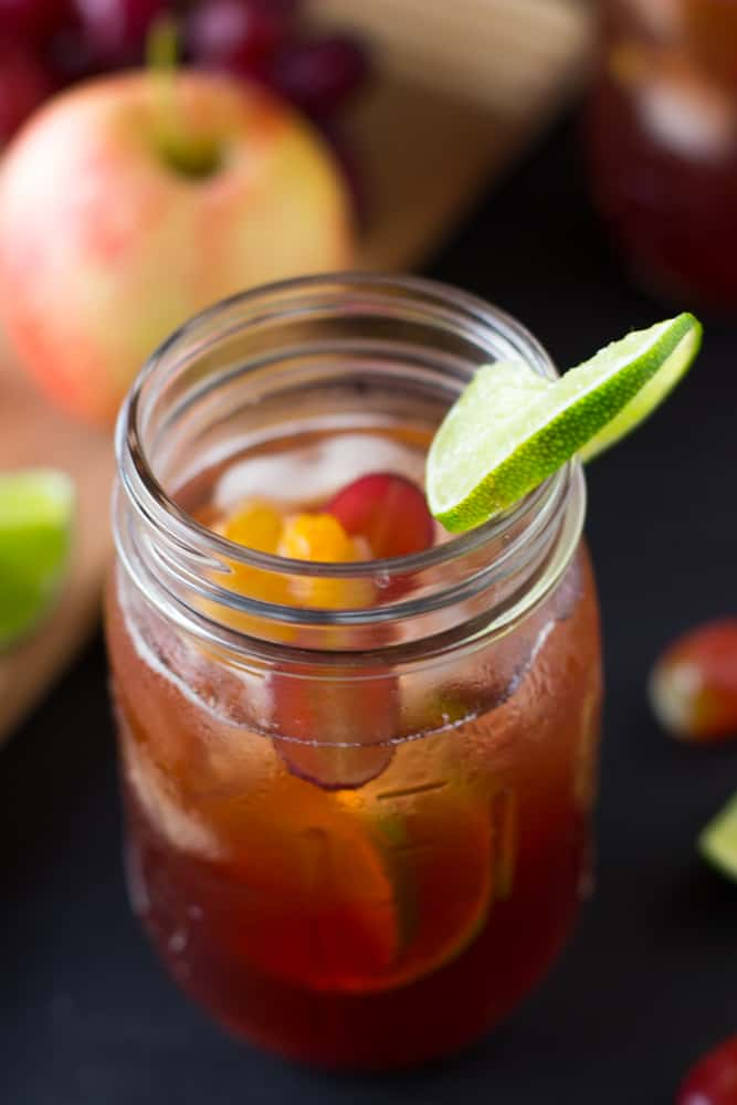 Top down shot of Rose Sangria in a mason jar with a slice of lime.