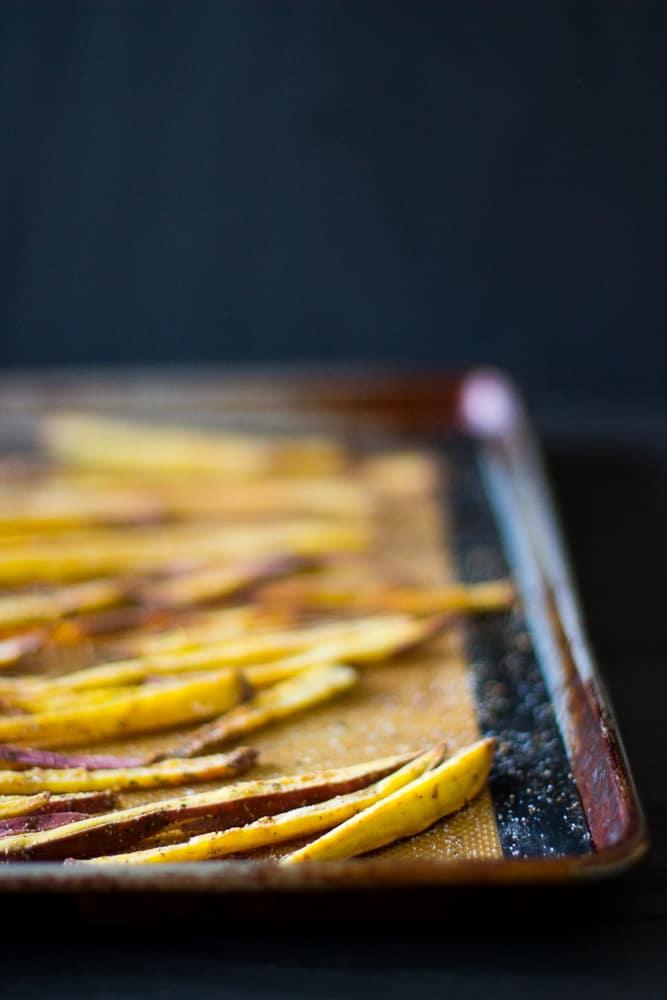 Sweet potato fries on a baking sheet.