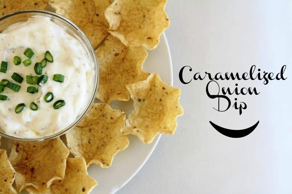 Caramelised onion dip on a plate with chips.