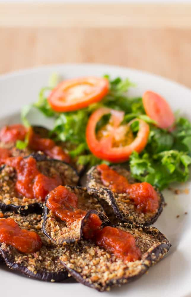 Almond-Crusted Baked Eggplant is a crunchy and delicious way to enjoy eggplant, topped with juicy marinara sauce! #vegan #meatless #meatlessmondays #dinner #glutenfree