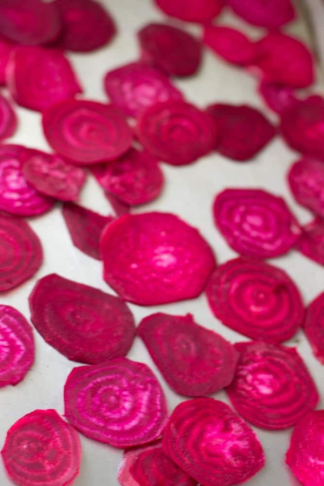 Slices of beet on a baking sheet.