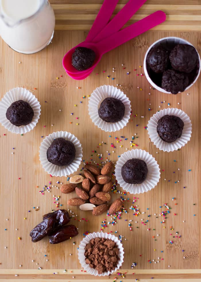 Top down shot of brownie bites in paper cups.