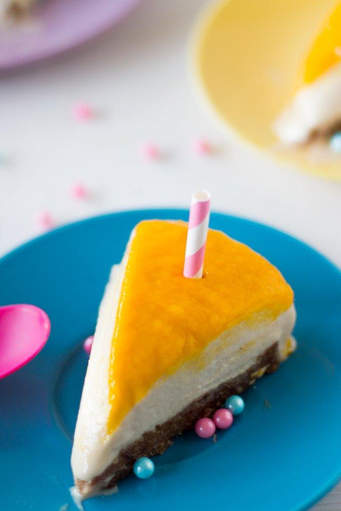Vegan Mango Coconut Cheesecake is a creamy no bake cheesecake that you'll fall in love with! Made with only natural sweeteners, this cheesecake is both great for you and incredibly delicious! #vegan #cheesecake #mango #coconut #dessert-3