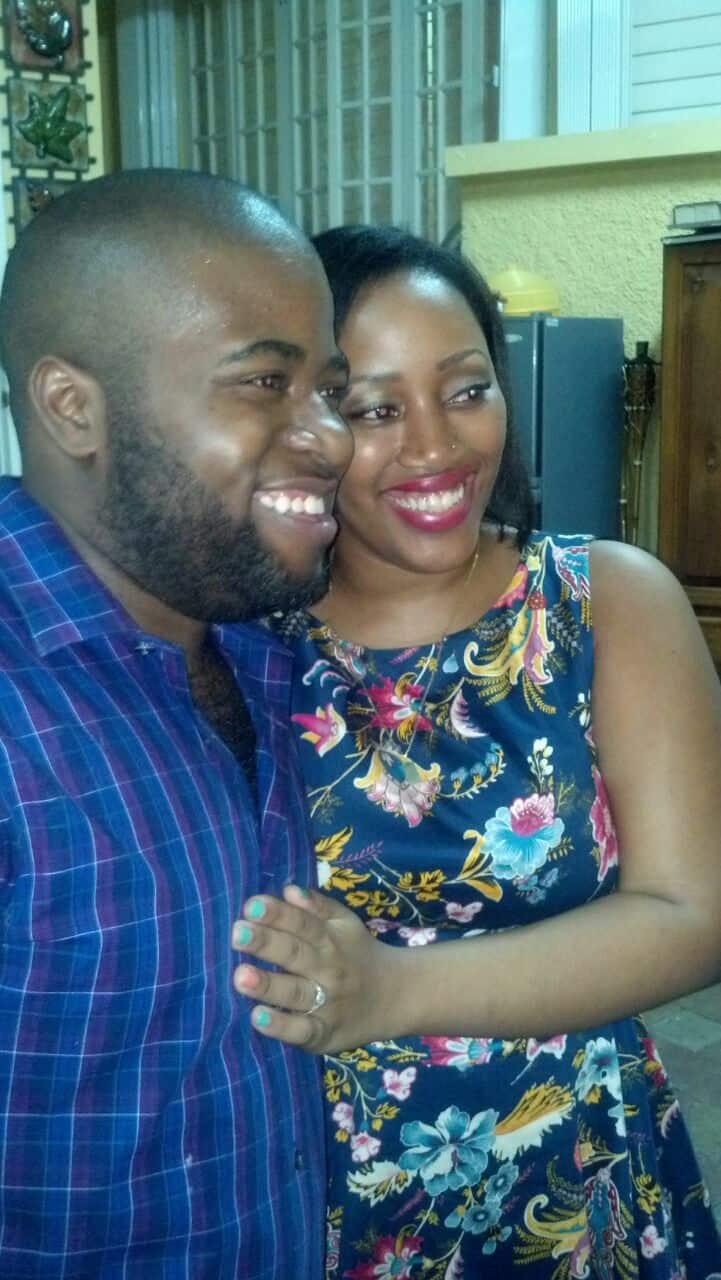 Jessica and fiancé smiling.