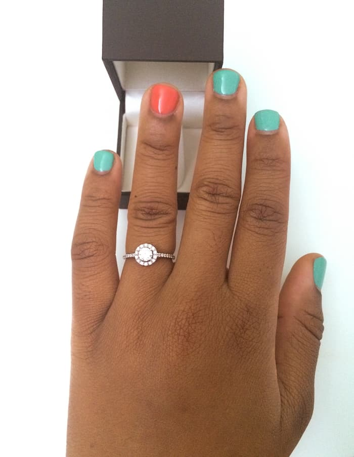 Hand with engagement ring.