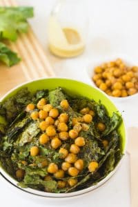 Kale and chickpea salad in a green bowl.