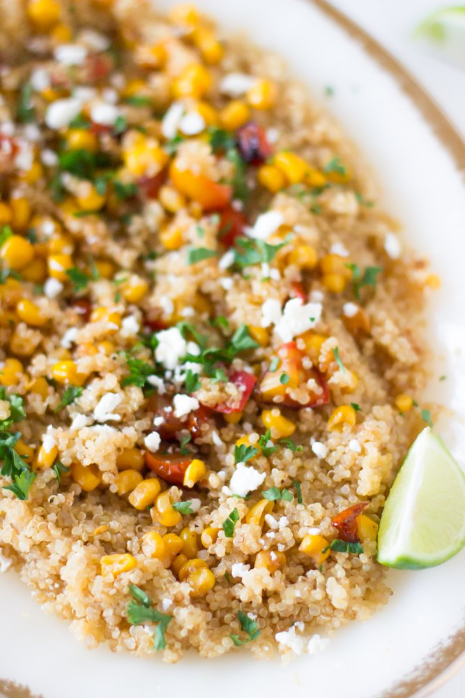 Quinoa and Corn Salad with Honey-Lime Dressing is a hearty and delicious salad also made with roasted tomatoes and feta cheese for the perfect summer salad! #healthy #vegetarian #quinoa #salad #lunch #corn
