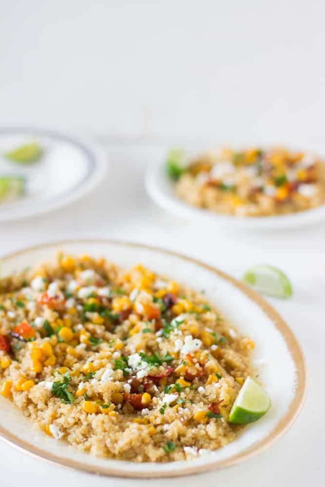 Quinoa and Corn Salad with Honey-Lime Dressing is a hearty and delicious salad also with roasted tomatoes and feta cheese that will leave you wanting more! #healthy #vegetarian #quinoa #salad #lunch #corn