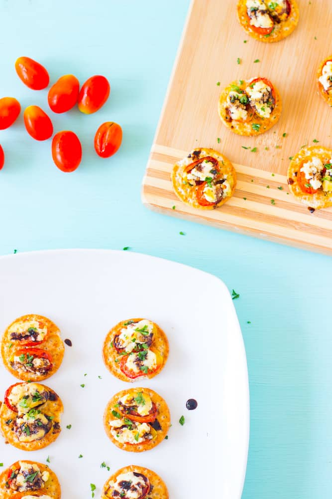 Roasted Tomatoes, Feta and Goat Cheese Bites are both kid and adult approved for an after-school snack or afternoon snack that takes less than 20 minutes to make! #snack #afterschoolsnack #vegetarian-4