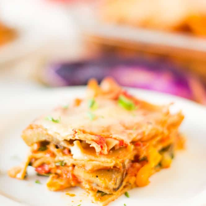 Close up of a lasagna slice on a white plate.