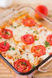 Cheesy casserole in a glass dish.