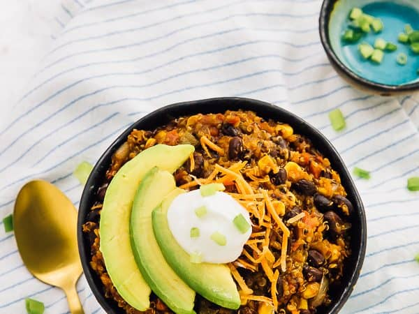 This Vegan Crockpot Chili is made with quinoa and black beans, needs only 10 minutes prep then right into the crockpot! It results in a thick, filling and delicious chili. via https://jessicainthekitchen.com