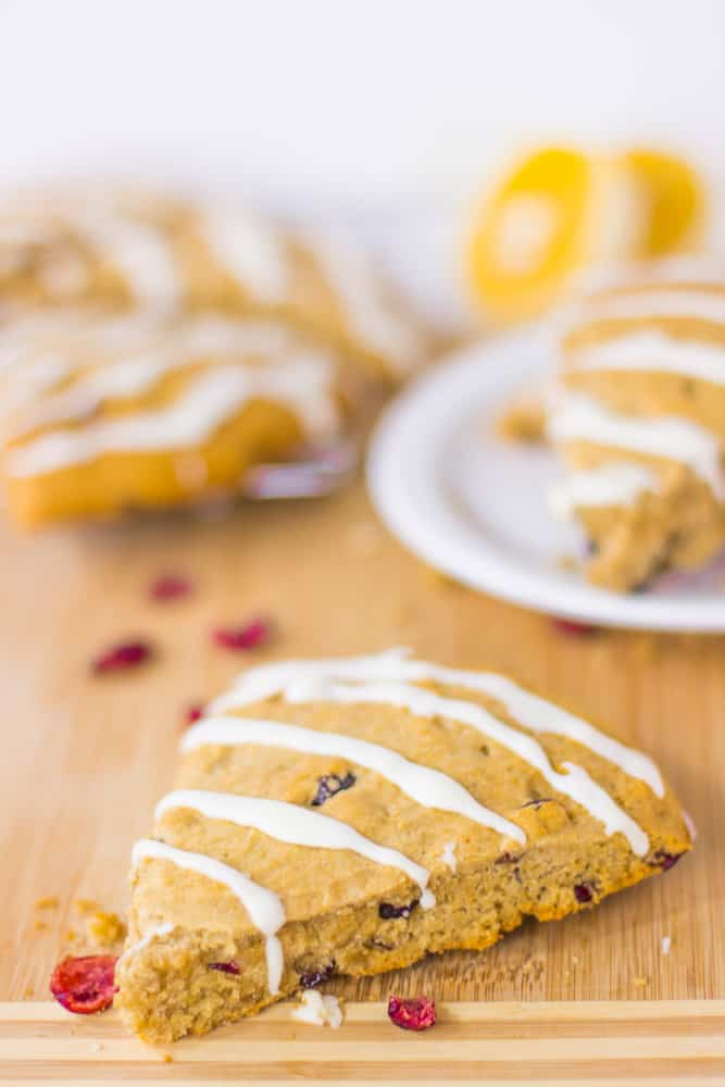These Vegan Cranberry Orange Scones have a dreamy orange glaze, are packed with cranberries and are SO delicious and gluten free! #vegan #glutenfree #cranberryorangescones #fall