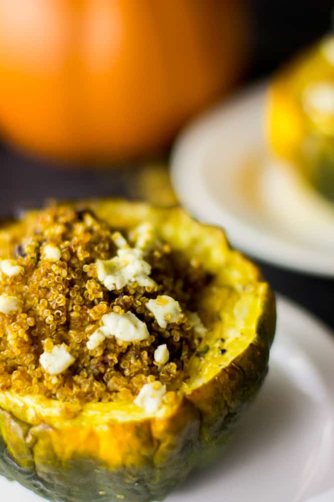 This Vegetarian Stuffed Acorn Squash is baked with quinoa, brown butter, goat cheese and delicious sun dried tomato! It's healthy and so easy to make!