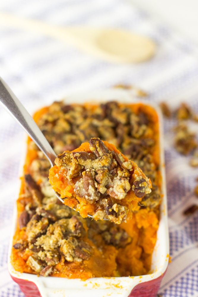 This Skinny Sweet Potato Casserole with Maple Pecan Topping is a vegan, light and healthy twist to traditional sweet potato. All the comfort food, less than half the calories! #vegan #sweetpotato #lowcarb #pecans #thanksgiving #sweetpotatocasserole