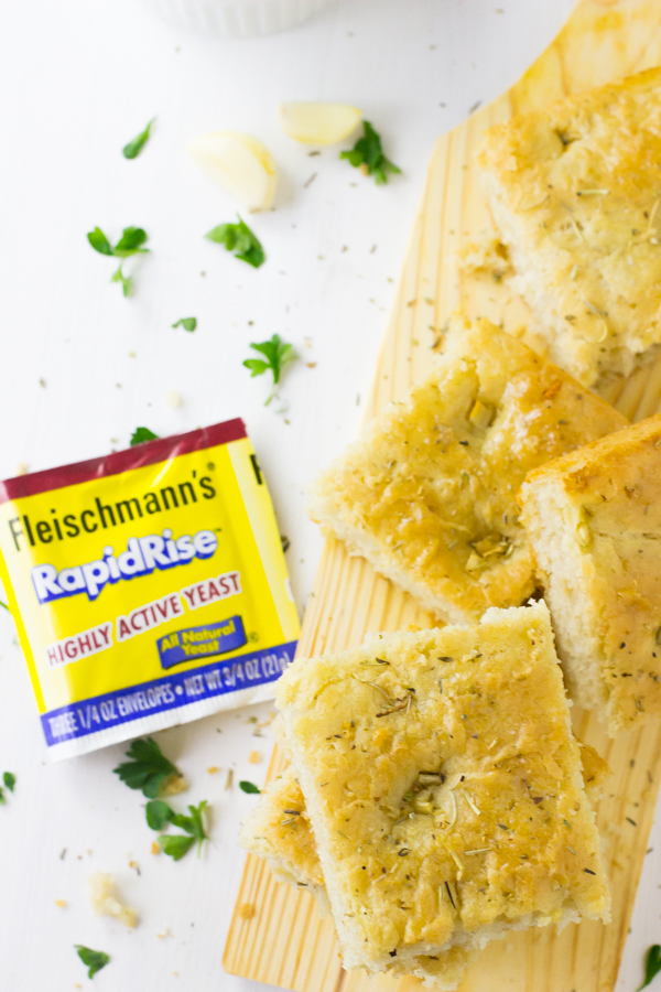 This Garlic and Rosemary Focaccia Bread is the BEST I've ever had! It's a definitely crowd pleaser made in just one bowl with roasted garlic and fragrant rosemary and is incredibly delicious! #focaccia #fleischmanns #bread #garlic #easy-6