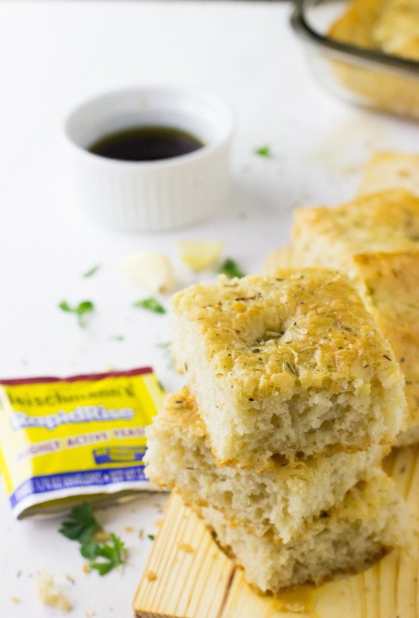 This Garlic and Rosemary Focaccia Bread is the BEST I've ever had! It's a definitely crowd pleaser made in just one bowl with roasted garlic and fragrant rosemary and is incredibly delicious! #focaccia #fleischmanns #bread #garlic #easy-7