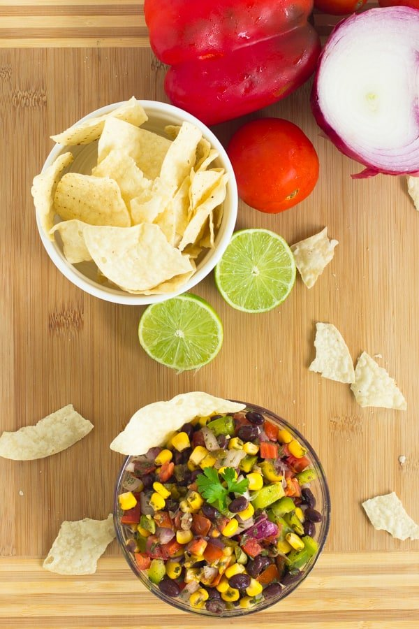 Overhead shot of black bean salsa with a bowl of chips.