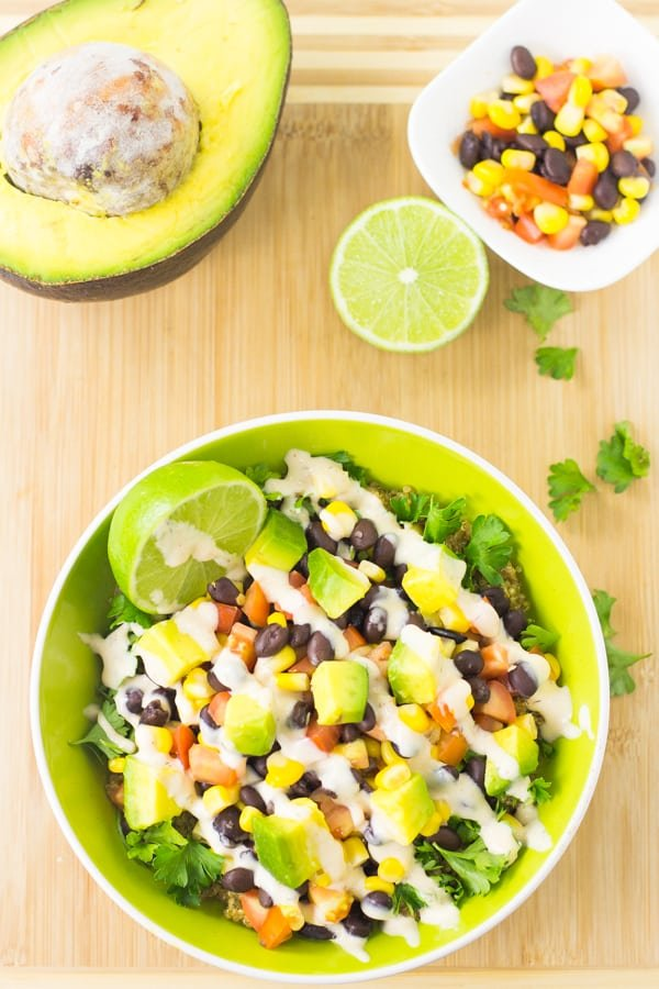 This Quinoa and Black Bean Burrito Bowl such a quick and easy meal that is deliciously nutritious, filling and topped with a creamy chipotle dressing!