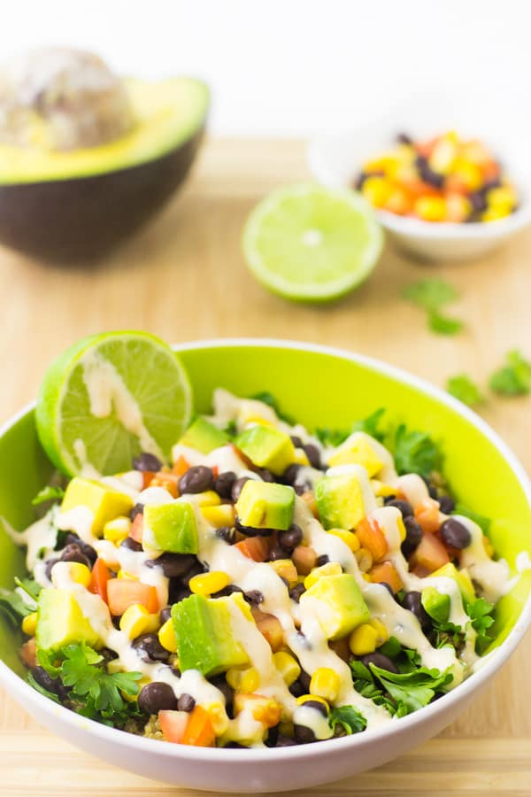 This Quinoa and Black Bean Burrito Bowl is loaded with nutrition, so easy to make and topped with a creamy chipotle dressing!