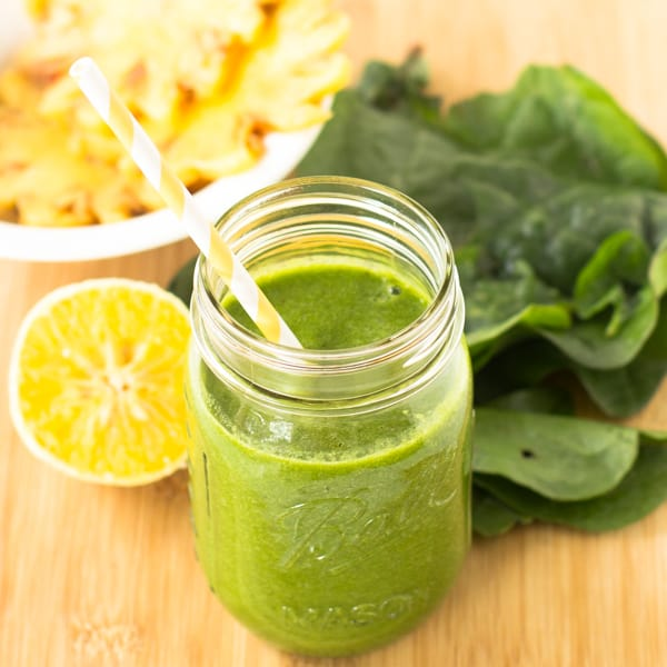 This Tropical Green Smoothie is one of my favorite green smoothies - loaded with spinach, pineapples, orange juice and bananas. It's only 255 calories and deliciously smooth!_