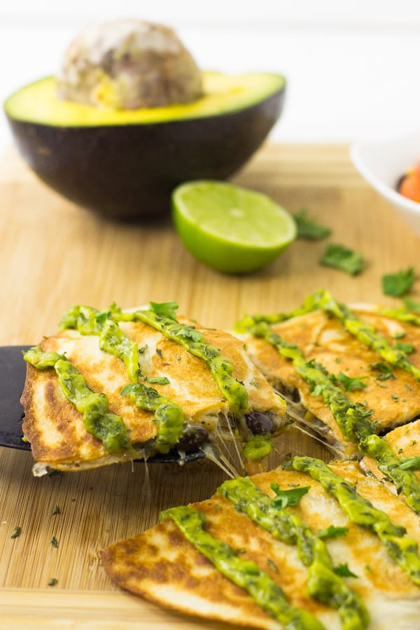These Mexican Quesadillas with Avocado Cilantro Cream Sauce are a quick, easy and delicious weeknight meal that's creamy, crispy and tasty! via https://jessicainthekitchen.com