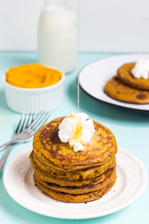 Gluten free pumpkin pancakes on a white plate.