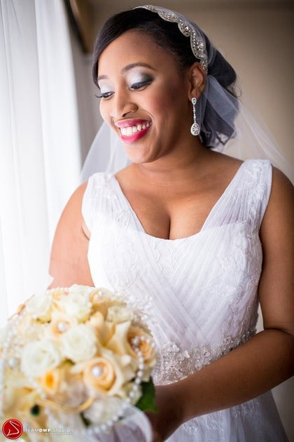 Jessica smiling in her wedding dress.