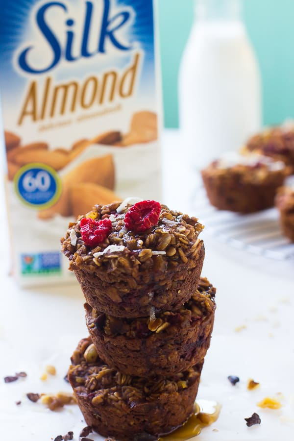 These Chocolate Raspberry Baked Oatmeal Cups are perfect for busy mornings! They taste like chewy delicious oatmeal cookies and are gluten free!