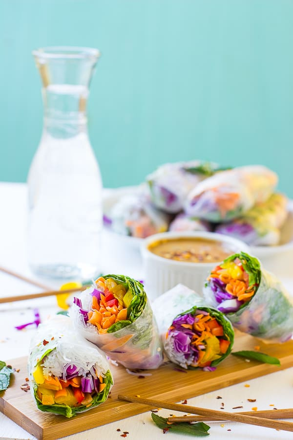 Fresh spring rolls on a table with dip.